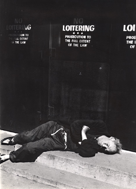 "Martin Steingesser - Bum Sleeping under a ""No Loitering"" sign in New York City, NY"